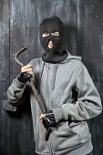 Portrait of a burglar with a crowbar poster