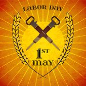May Day. May 1st. Labor Day background with crossed jackhammers and wheat ears over retro rays background. Poster, greeting card or brochure template, symbol of work and labor, vector icon poster
