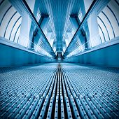 diminishing stairway of blue empty business escalator poster