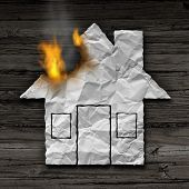 House fire concept and residential smoke disaster and burning destruction symbol as crumpled paper shaped as a family home residence as a 3D illustration on rustic wood. poster
