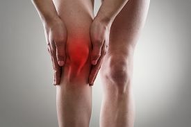 Tendon problems on woman's leg indicated with red spot. Joint inflammation concept.