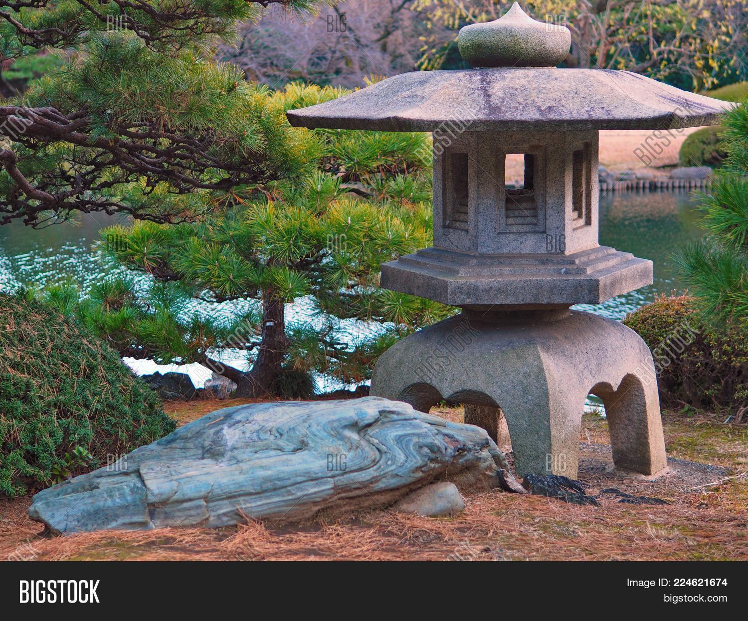 Japanese Water Garden In Tokyo With Large Old Stone Lantern. Japanese Water  Garden In Tokyo
