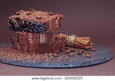 Close-up of coffee dessert. Cake and powder. Convolution of cinnamon.