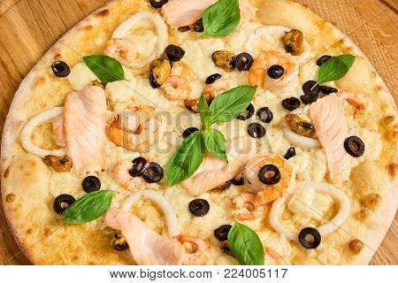 Italian pizza with seafood closeup, view from above. Seafood pizza close up.