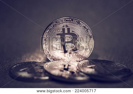 Coins golden  bitcoin of the background, color trend 2018 toned