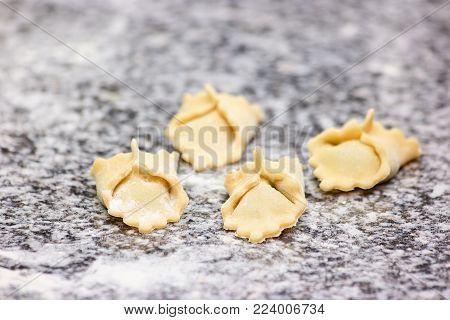 Uncooked ravioli ready for cooking. Traditional italian ravioli and dough.