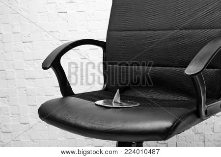 Office armchair with large pin. April fool's day celebration