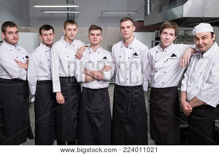 Chef and his team of professional staff at restaurant. Teamwork brings success to any business