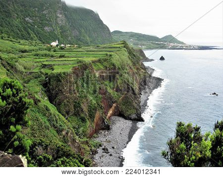 Coast of Flores island with cliffs and a sea stack, The Azores
