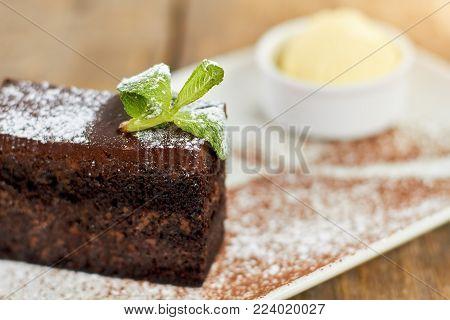 Close up chocolate piece of cake filling. Chocolate cake stuffing close up.