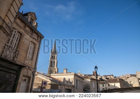 Collegial church (Eglise Collegiale) of Saint Emilion, France, taken during a sunny afternoon surrounded by the medieval part of the village. Famous for its wine, the city and its religious complex is one of oldest parts of Aquitaine region