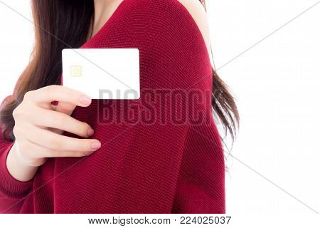 Woman holding blank business credit card for mock up, girl with debit card on hand, commercial with shopping payment concept.