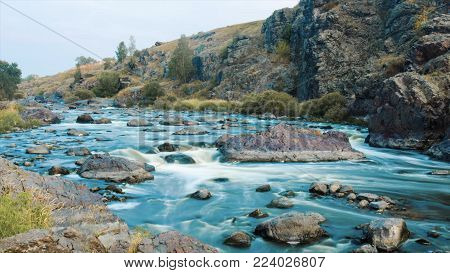 Beautiful River Water Flowing Through Stones And Rocks At Dawn. Video. Flow Of The River Through The
