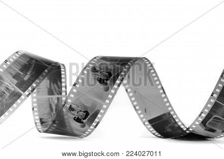 spiral of black and white negative film on white background, isolated
