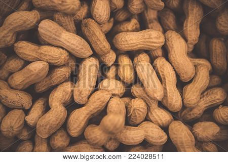 Peanuts background, tasty high-calorie nuts, monkey nuts in the nutshell, abstract groundnuts wallpaper