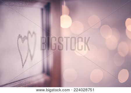 Open doors to love, two hand drawn hearts on the open door, festive blurry bokeh lights background, romantic winter holiday, conceptual photo of first affection or true love, Valentines day holiday