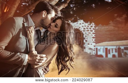 Fashionable young couple posing in a romantic scenery