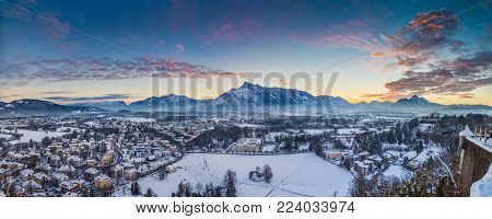 Panoramic view of the historic city of Salzburg from famous Hohensalzburg Fortress in winter at sunset, Salzburger Land, Austria