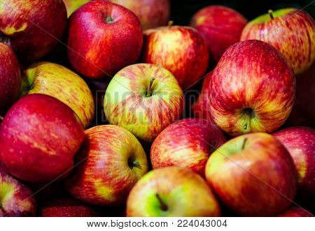 Large group of red apples background, scattered