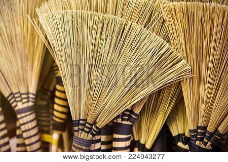 Traditional African brooms background on a wall