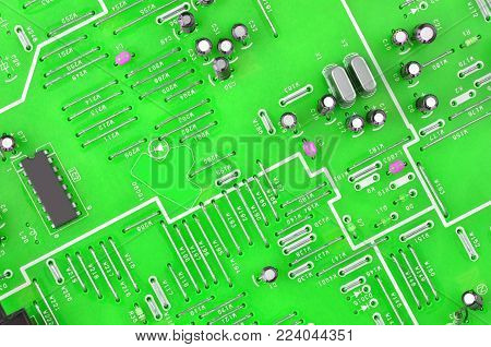 Close up of printed green VHS player circuit board
