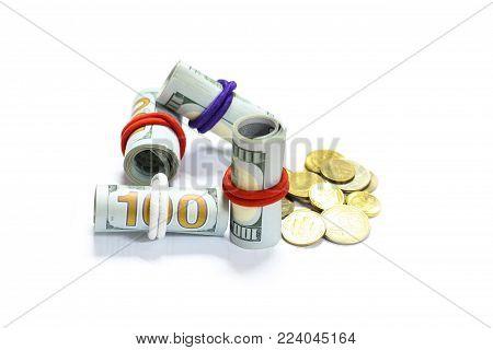 US Dollar bills banknotes with white background. Rolled Dollar bills. Money coins.