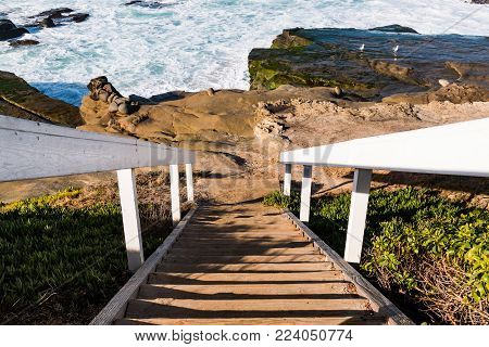 Staircase to rock formations at Windansea Beach in La Jolla, California.