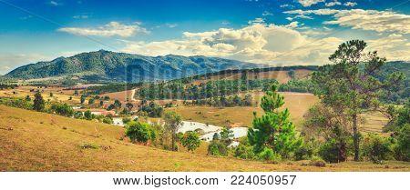 Beautiful rural landscape, mountain on background. Vang Vieng, Laos. Panorama