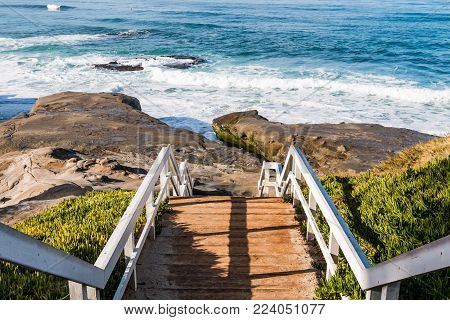 Staircase and landing for beach access to Windansea Beach in La Jolla, California.