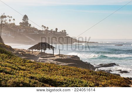 Hazy morning on Windansea Beach in La Jolla, California with iconic surfer shack.