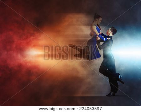 Pair of dancers dancing ballroom smoke background