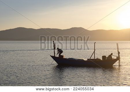 Silhouette Of Fisherman On Fishing Boat In Morning At Ban Hua Leam, Chanthaburi, Thailand