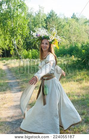 Attractive Woman Portrait with Wreath of Flowers. Ivan Kupala Holiday Celebration