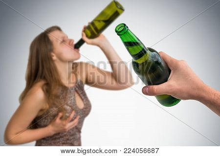Unfocused Woman Drinking Alcohol And Hand Of Man With Beer