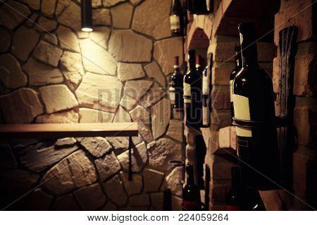 Wine bottles close up view at the underground cellar