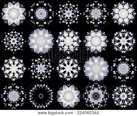 set of white snowflakes isolated on  black background. abstract blur background snowflakes from white clouds. background of snowflakes pattern of a kaleidoscope. kaleidoscopic arabesque. geometrical ornament snow pattern