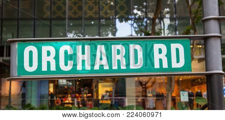 Green Orchard Road signpost in Singapore's iconic shopping street.