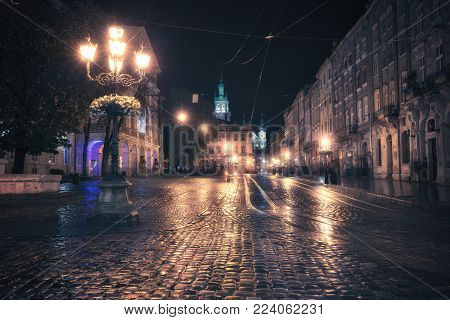Vintage style image of old European city at night