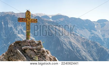 Colca Canyon, Peru - August 2017: The Cross monument at the Condor Canyon viewpoint
