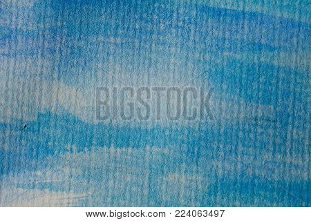 Abstract blue watercolor background. Blue watercolor on textured paper. Abstract texture and background for designers. Blue watercolor brush strokes. Colorful hand painted watercolor.