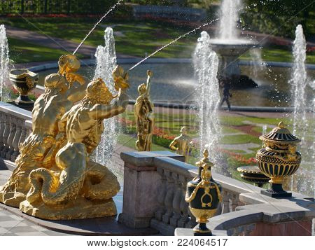 Peterhof, St. Petersburg, Russia - June 4, 2017: Golden statues of the Grand Cascade. The cascade was built in 1715-1724 and is one of the remarkable fountain constructions in the world