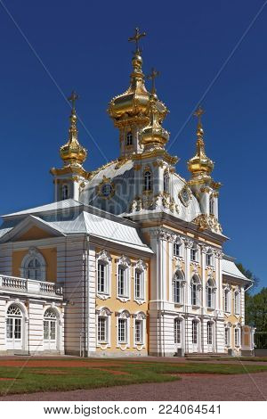 PETERHOF, ST. PETERSBURG, RUSSIA - JUNE 4, 2017: East Chapel flanking the central buildings of Grand Peterhof Palace. The palace-ensemble is recognized as a UNESCO World Heritage site