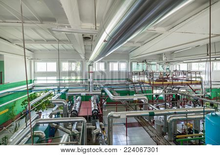 Industrial boiler room. Complex system of pipelines, pumps and valves.