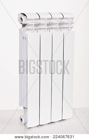 Heating Radiators Batteries , Aluminum, Bimetal. On White Background In Studio.