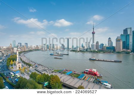 Shanghai, China - Nov 15, 2017: View of Lujiazui and The Bund in Shanghai. The Bund is a waterfront area with many historical buildings built by former foriegn settlements.