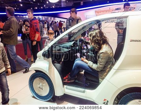 Moscow, Russia - 30 August, People at the auto show, 30 August, 2014. New ideas of the auto industry at the Moscow Motor Show.