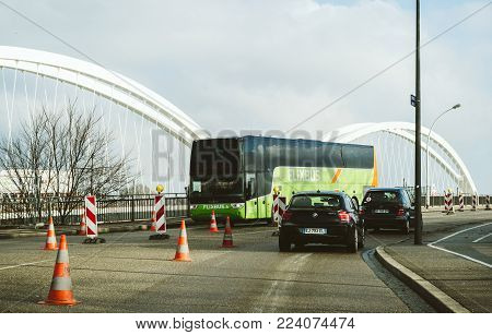 KEHL, GERMANY - JAN 16, 2017: VANHOLL Flixbus green bus on the border bridge between Germany and France transporting tourists to France - intercity low-cost bus service in Europe