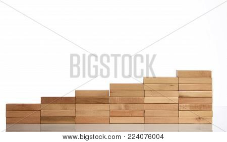 Wood block stacking as step stair isolated on white background with copy space for text, Business concept for growth success process, close-up