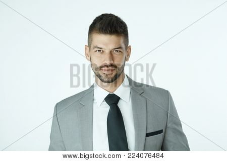 Portrait of businessman over white background.