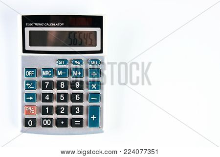 Calculator isolated on white background with copy space, close-up, top view. Silver calculator on white background as background business concept and Education concept